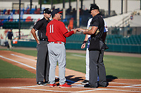 Palm Beach Cardinals manager Dann Bilardello (11) during the lineup exchange with home plate umpire Dillon Wilson (right), field umpire Ben Fernandez (left), and Lakeland Flying Tigers manager Andrew Graham (17) before a Florida State League game on May 22, 2019 at Publix Field at Joker Marchant Stadium in Lakeland, Florida.  Palm Beach defeated Lakeland 8-1.  (Mike Janes/Four Seam Images)