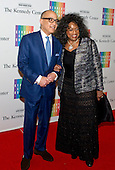 Jessye Norman and Darren Walker arrive for the formal Artist's Dinner honoring the recipients of the 2014 Kennedy Center Honors hosted by United States Secretary of State John F. Kerry at the U.S. Department of State in Washington, D.C. on Saturday, December 6, 2014. The 2014 honorees are: singer Al Green, actor and filmmaker Tom Hanks, ballerina Patricia McBride, singer-songwriter Sting, and comedienne Lily Tomlin.<br /> Credit: Ron Sachs / Pool via CNP