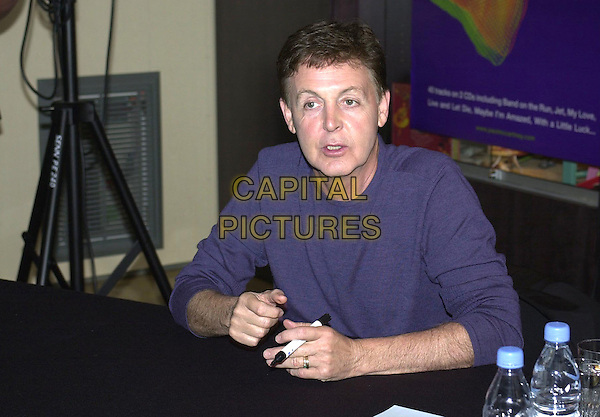 PAUL McCARTNEY.at FNAC, record selling shop on rue d'Antibes to sign autographs, Cannes Film Festival, France,.9th May 2001..half length.Ref: PL.www.capitalpictures.com.sales@capitalpictures.com.©Capital Pictures.