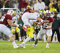 STANFORD, CA - November 7, 2013:  Stanford Cardinal linebacker AJ Tarpley (17) and linebacker Jarek Lancaster (35) sack the Oregon quarterback during the Stanford Cardinal vs the Oregon Ducks at Stanford Stadium in Stanford, CA. Final score Stanford Cardinal 26, Oregon Ducks  20.