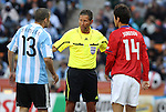 17 JUN 2010: Referee Frank de Bleeckere (BEL) lectures Walter Samuel (ARG) (13) and Lee Jung Soo (KOR) (14). The Argentina National Team defeated the South Korea National Team 4-1 at Soccer City Stadium in Johannesburg, South Africa in a 2010 FIFA World Cup Group E match.