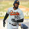 David Washington #30, Long Island Ducks first baseman, rounds the bases after connecting for a two-run home run in the bottom of the second inning of the team's season home opener against the Southern Maryland Blue Crabs at Bethpage Ballpark in Central Islip, NY on Friday, May 4, 2018.