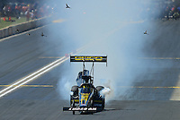 Jul, 22, 2012; Morrison, CO, USA: NHRA top fuel dragster driver Morgan Lucas drives through a flock of birds at the finish line during the Mile High Nationals at Bandimere Speedway. Mandatory Credit: Mark J. Rebilas-US PRESSWIRE