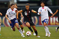 14 MAY 2011: USA Women's National Team midfielder Carli Lloyd (10) dribbles the ball through Japan National team Homare Sawa and Shinobu Ohno during the International Friendly soccer match between Japan WNT vs USA WNT at Crew Stadium in Columbus, Ohio.