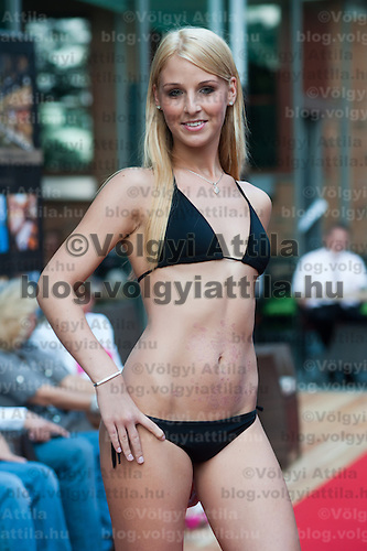 Fanni Zsigo a participant of the Beauty Queen contest attends a bikini tour in Hotel Abacus, Herceghalom, Hungary on July 07, 2011. ATTILA VOLGYI