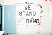 """A poster reading """"We Stand With Rand"""" and signed by supporters hangs on a wall at the campaign headquarters of Kentucky senator and Republican presidential candidate Rand Paul during a celebration at his campaign headquarters in Manchester, New Hampshire."""
