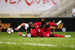 Akande, Alexander Oluwatayo of Hong Kong (R) fights for the ball with Tareq Khattab of Jordan (L) during the International Friendly match between Hong Kong and Jordan at Mongkok Stadium on June 7, 2017 in Hong Kong, China. Photo by Marcio Rodrigo Machado / Power Sport Images