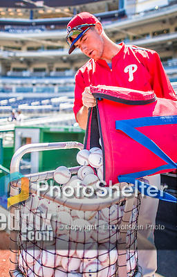 23 May 2015: The Philadelphia Phillies prepare batting practice ball prior to a game against the Washington Nationals at Nationals Park in Washington, DC. The Phillies defeated the Nationals 8-1 in the second game of their 3-game weekend series. Mandatory Credit: Ed Wolfstein Photo *** RAW (NEF) Image File Available ***
