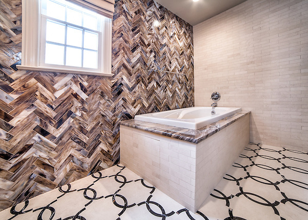 This custom bathroom features a Seine water jet mosaic floor shown in Ivory Cream and Saint Laurent with 3&quot;x 12&quot; Lavastone bricks and 3&quot;x 12&quot; Ivory Cream bricks.<br />
