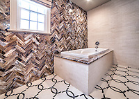 "This custom bathroom features a Seine water jet mosaic floor shown in Ivory Cream and Saint Laurent with 3""x 12"" Lavastone bricks and 3""x 12"" Ivory Cream bricks.<br />