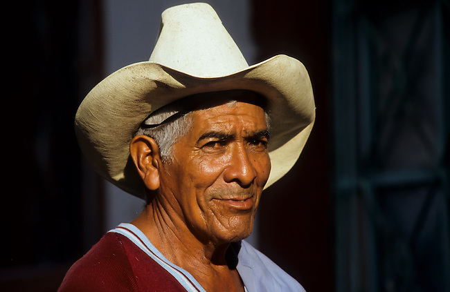 Portrait of a smiling mexican man with a hat