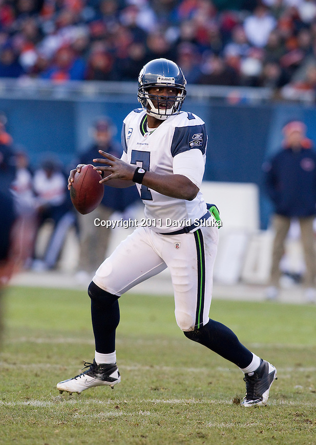 Seattle Seahawks quarterback Tarvaris Jackson (7) looks for a receiver during a week 15 NFL football game against the Chicago Bears on December 18, 2011 in Chicago. The Seahawks won 38-14. (AP Photo/David Stluka)