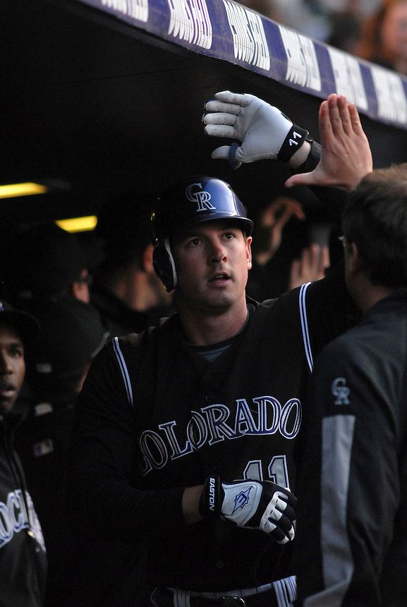 Colorado Rockies outfielder Brad Hawpe is congratulated in the dugout after scoring a run against the Los Angeles Dodgers at Coors Field in Denver, Colorado on May 3, 2008. FOR EDITORIAL USE ONLY. FOR EDITORIAL USE ONLY