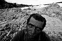 Gold seeker portrait at Agua Branca gold mining village, Amazon rain forest deforestation, Para State, Brazil.