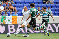 Alan Hutton (2) of Tottenham Hotspur F. C. takes a shot. Tottenham Hotspur F. C. and Sporting Clube de Portugal played to a 2-2 tie during a Barclays New York Challenge match at Red Bull Arena in Harrison, NJ, on July 25, 2010.