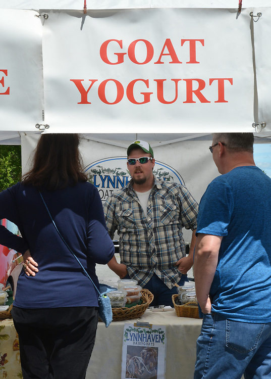 Customers being served at the Lynnhaven Nubians Farm Booth at the Opening Day of the 2017 Saugerties Farmer's Market on Saturday, May 27, 2017. Photo by Jim Peppler. Copyright/Jim Peppler-2017.
