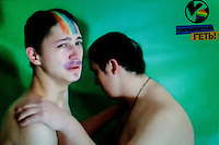 A still from a video made by members of 'Occupy Pedophilia', a militantly homophobic group that specialises in hunting and filming violent attacks on suspected gays and pedophiles (the group believes that gays and pedophiles are almost equally immoral and that most gays are pedophiles and vice-verse). On the popular online TV-show 'Occupy Pedophilia' victims are tricked into false dates. But instead of a romantic encounter, this band of armed ultra-nationalists are lying in wait. Once caught and confronted the victim is sexually humiliated and tortured, while everything is filmed, posted publicly and shared online. According to the group more than 70 videos have been made so far - with more to come. This video shows two unidentified men, one in tears, who are being filmed by a gang of men. The TV station's logo, in the corner, bears the title 'NETTING THE FAGGOTS!'. (MANDATORY CREDIT   photo: Mads Nissen/Panos Pictures /Felix Features)