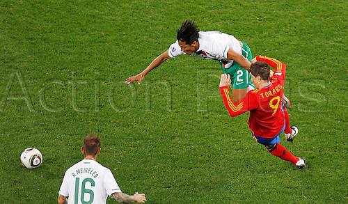 29 06 2010  Fernando Torres of Spain Tackles with Bruno Alves 2nd of Portugal. FIFA World Cup, Spain v Portugal, Green Point stadium in Cape Town South Africa. June 29, 2010.