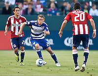 CARSON, CA – June 18, 2011: FC Dallas midfielder Eric Alexander attempts to move past Chivas USA defender Zarek Valentin (20) during the match between Chivas USA and FC Dallas at the Home Depot Center in Carson, California. Final score Chivas USA 1, FC Dallas 2.