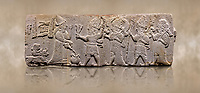 Aslantepe Hittite relief sculpted orthostat stone panel. Limestone, Aslantepe, Malatya, 1200-700 B.C. . Anatolian Civilisations Museum, Ankara, Turkey<br /> <br /> Scene of the king's offering drink and sacrifice to the gods. King pours from the pitcher to the vessel (libation); behind the king is a servant bringing a sacrifice. Storm God across the king holds Teshup, a triple lightning bundle - sickle, and a spear-mace set in the other orthostat; the goddess Ishtar holds weapon in both. All six figures have shoes with the curled ends. <br /> <br /> Against a brown art background.