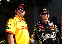 Nov 14, 2010; Pomona, CA, USA; NHRA funny car drivers Jeff Arend (left) and Paul Lee during the Auto Club Finals at Auto Club Raceway at Pomona. Mandatory Credit: Mark J. Rebilas-