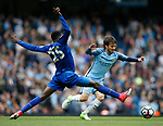 Wilfred Ndidi of Leicester City stretches to try and stop \mc21\ during the English Premier League match at the Etihad Stadium, Manchester. Picture date: May 13th 2017. Pic credit should read: Simon Bellis/Sportimage
