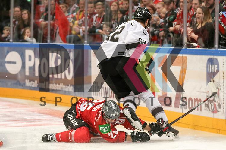 Koelns Patrick Hager (Nr.25) geht zu Boden und verteidigt den Puck gegen Nuernbergs Oliver Mebus (Nr.22)  beim Spiel in der DEL, Koelner Haie (dunkel) - Nuernberg Ice Tigers (weiss).<br /> <br /> Foto &copy; PIX-Sportfotos *** Foto ist honorarpflichtig! *** Auf Anfrage in hoeherer Qualitaet/Aufloesung. Belegexemplar erbeten. Veroeffentlichung ausschliesslich fuer journalistisch-publizistische Zwecke. For editorial use only.