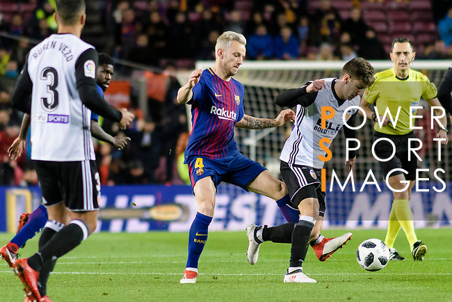 Ivan Rakitic of FC Barcelona (L) fights for the ball with Luciano Vietto of Valencia CF (R) during the Copa Del Rey 2017-18 match between FC Barcelona and Valencia CF at Camp Nou Stadium on 01 February 2018 in Barcelona, Spain. Photo by Vicens Gimenez / Power Sport Images
