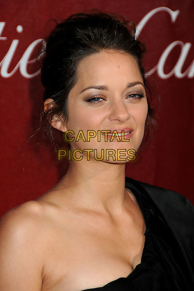 MARION COTILLARD .Palm Springs International Film Festival Awards Gala 2010 held at the Palm Springs Convention Center, Palm Springs, California, USA, .5th January 2010..portrait headshot one shoulder black hair up.CAP/ADM/BP.©Byron Purvis/AdMedia/Capital Pictures.