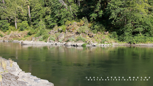 Look closely for the small black bear on the beach across the river near the tiny creek.