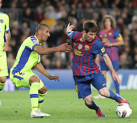 10.04.2012 Bacelona, Spain. La Liga. Picture show Leo Messi (R) and Cata (L) in action during match between FC Barcelona against Getafe at Camp Nou