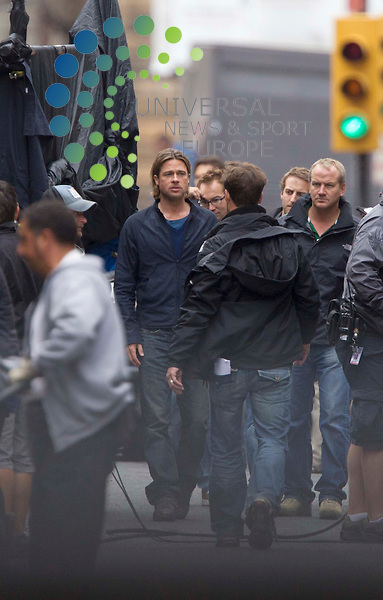 Brad Pitt on set in Glasgow as the filming for his film World War Z gets underway in George Square, Scotland..Picture: Universal News And Sport (Scotland). 16 August 2011. www.unpixs.com..