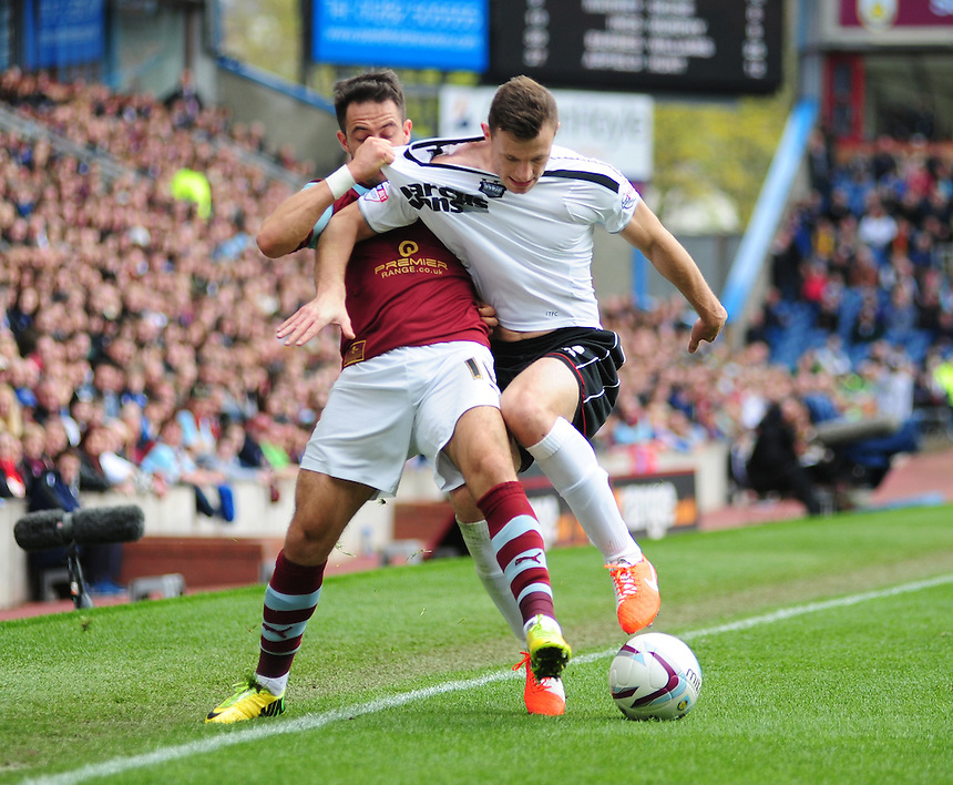 Burnley's Danny Ings vies for possession with Ipswich Town's Tommy Smith <br /> <br /> Photo by Chris Vaughan/CameraSport<br /> <br /> Football - The Football League Sky Bet Championship - Burnley v Ipswich Town - Saturday 26th April 2014 - Turf Moor - Burnley<br /> <br /> &copy; CameraSport - 43 Linden Ave. Countesthorpe. Leicester. England. LE8 5PG - Tel: +44 (0) 116 277 4147 - admin@camerasport.com - www.camerasport.com