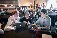 NWA Democrat-Gazette/CHARLIE KAIJO Sebastian Cypert 16 of Rogers (from left), Andrew Brown 16 of Rogers, Ben Burdess 16 of Rogers and Adam Siwiec 16 of Rogers look at their computers during a presentation, Thursday, March 15, 2018 at The Record in Bentonville. <br /> <br /> The nonprofit TeenDevConf in NWA gives grants to teens interested in learning about new technology. Its goal is to benefit &ldquo;hatchling hackers&rdquo; so they can use their powers for good.<br /> <br /> Julian Sanker, a teen, started a fundraising campaign with a goal of funding enough for 15 students to attend a developer&rsquo;s conference for free. He&rsquo;s now raised enough for more than 25 students to attend. The Nowhere Developers Conference hosted speakers from Walmart, Google, MailChimp, among others.