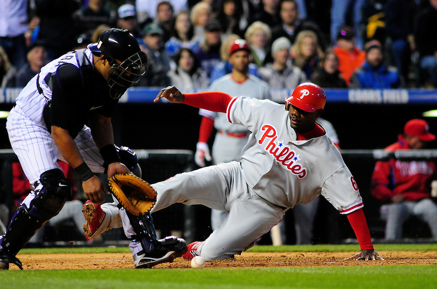 April 11, 2009: Phillies first baseman and 2009 National League Most Valuable Player candidate Ryan Howard slides into home ahead of the tag by Rockies catcher Yorvit Torrealba during a game between the Philadelphia Phillies and the Colorado Rockies at Coors Field in Denver, Colorado. The Phillies beat the Rockies 8-4.