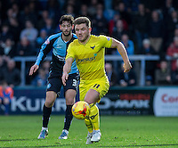 Alex MacDonald of Oxford United in action during the Sky Bet League 2 match between Wycombe Wanderers and Oxford United at Adams Park, High Wycombe, England on 19 December 2015. Photo by Andy Rowland.