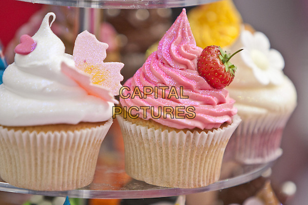Cupcakes.BBC Good Food Show London 2012, Olympia, Kensington, London, England..November 10th 2012.gv general view icing dessert pink white strawberry sweets.CAP/MM/PP.©Mike Mustard/PP/Capital Pictures
