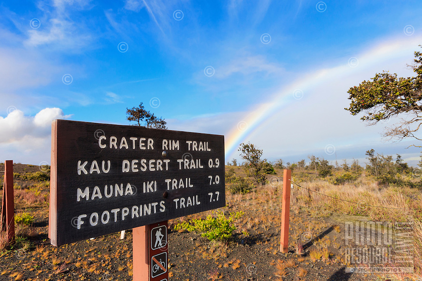 A rainbow is seen behind a trail sign at Hawai'i Volcanoes National Park, Big Island.