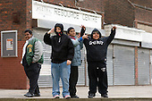 Boys waiting outside the community centre on Home Housing's Rayners Lane Estate, Harrow.