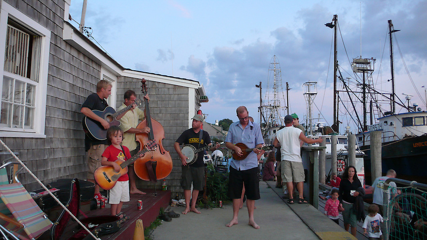 A pick up band plays on the dock on Menemsha Harbor..........