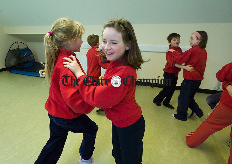 Katie O Brien and Claire Costello dancing a set at Ballyvaughan NS. Photograph by John Kelly.