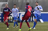 Adel Taarabt of QPR passes past Alou Diarra of Chicago Fire