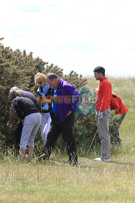 Shane Smyth helped by his parents Vicki and Des search for his drive on the 18th on the first round of the final day at the East of Ireland Amateur Open Championship 2011 in Co.Louth Golf Club...(Photo credit should read Jenny Matthews www.newsfile.ie)....This Picture has been sent you under the conditions enclosed by:.Newsfile Ltd..The Studio,.Millmount Abbey,.Drogheda,.Co Meath..Ireland..Tel: +353(0)41-9871240.Fax: +353(0)41-9871260.GSM: +353(0)86-2500958.email: pictures@newsfile.ie.www.newsfile.ie.