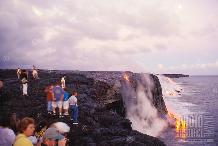 Tourists watching lava flow into the sea, Hawaii Volcanoes National Park