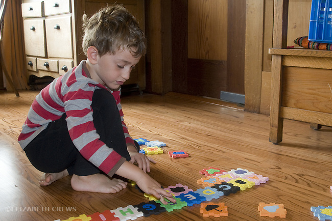 Berkeley CA Boy, five, matching picture shapes with correct letters on interlocking blocks  MR