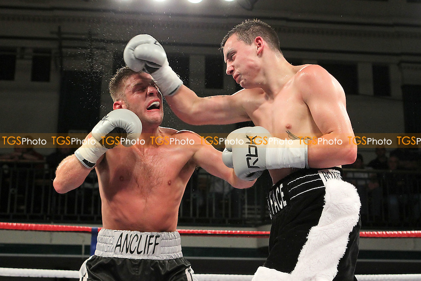 Mitchell Smith (black/white shorts) defeats James Ancliff in a Super-Featherweight boxing contest at York Hall, Bethnal Green, London, promoted by Frank Warren - 01/06/12 - MANDATORY CREDIT: Gavin Ellis/TGSPHOTO - Self billing applies where appropriate - 0845 094 6026 - contact@tgsphoto.co.uk - NO UNPAID USE