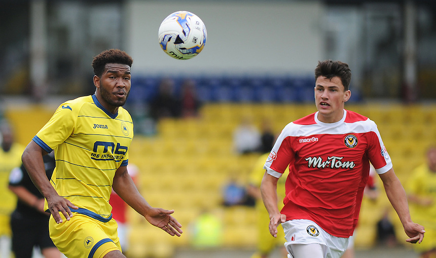 Torquay United's Tyrone Marsh under pressure from Newport County's Regan Poole<br /> <br /> Photographer Kevin Barnes/CameraSport<br /> <br /> Football - Pre Season Friendly - Torquay United v Newport County AFC - Saturday 18th July 2015 - Plainmoor - Torquay<br /> <br /> &copy; CameraSport - 43 Linden Ave. Countesthorpe. Leicester. England. LE8 5PG - Tel: +44 (0) 116 277 4147 - admin@camerasport.com - www.camerasport.com