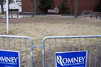 A man sits on a bench outside a Mitt Romney town hall meeting and rally at the Rochester Opera House in Rochester, New Hampshire, on Jan. 8, 2012. Romney is seeking the 2012 Republican presidential nomination.