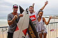SNAPPER ROCKS, Queensland/Australia (Sunday, March 4, 2012) Trainer John Gannon (AUS, Taj Burrow (AUS) and girlfriend Oleema Miller (USA)  The final day of the Quiksilver and Roxy Pro Gold Coast presented by Land Rover culminated today with perennial ASP World Title threat Taj Burrow (AUS), 33, and four-time ASP Womens World Champion Stephanie Gilmore (AUS), 24, taking the respective wins in clean two-to-three foot (1 metre) waves at the primary venue of Snapper Rocks.. .The opening stop on the 2012 ASP World Championship Tour, the Quiksilver and Roxy Pro Gold Coast enjoyed sunny weather, light winds and a capacity crowd for the final day of competition, with the worlds best surfers putting on a spectacular display of high-performance surfing.. .Burrow defeated dangerous South American Adriano De Souza (BRA), 25, in a Final that came down to the wire. De Souza caught a wave in the dying minutes and launched into a massive air-reverse, requiring a 7.87 out of a possible 10 to take the lead. The judges deliberated until after the siren sounded and when it was announced that De Souza came a mere 0.27 short, Burrow was chaired up the beach and declared the 2012 Quiksilver Pro Gold Coast champion..Stephanie Gilmore (AUS), 24, reigning four-time ASP Womens World Champion, her fourth Roxy Pro Gold Coast title after defeating ASP Top 17 sophomore Laura Enever (AUS), 20, in a hard-fought Final. Gilmore was dominant throughout the event, posting scores in the excellent range in every encounter throughout the draw. Gilmore jumps back to No. 1 on the ASP Womens World Championship Tour ratings, a spot she lost at this event last year after holding it for four years.. Photo: joliphotos.com
