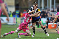 Nick Koster is tackled in possession. LV= Cup match, between Bath Rugby and Exeter Chiefs on January 26, 2013 at the Recreation Ground in Bath, England. Photo by: Patrick Khachfe / Onside Images